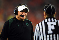Jan 10, 2011; Glendale, AZ, USA; Oregon Ducks head coach Chip Kelly talks with a referee during the first half of the 2011 BCS National Championship game against the Auburn Tigers at University of Phoenix Stadium.  Mandatory Credit: Mark J. Rebilas-