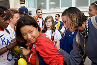 USWNT forward Abby Wambach signs an autograph for a fan following the game. The USWNT defeated Italy, 2-0, at the Suwon Sports Center in Suwon, South Korea.