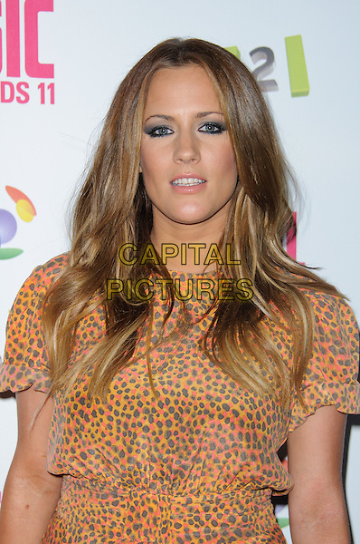 Caroline Flack.BT Digital Music Awards held at the Roundhouse, Chalk Farm, London, England..September 29th 2011.half length brown red orange dress leopard print  .CAP/CJ.©Chris Joseph/Capital Pictures.