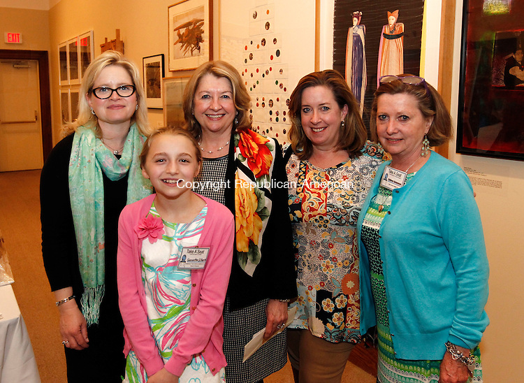 """Waterbury, CT- 02 May 2014-050214CM10- Social moments--- Left to right, Kim Gilbert and her daughter, Samantha Gilbert, 11, one of the artists, both from Middlebury, Tara Shea President Board of Directors at Waterbury Youth Services, Sheila M. Powers, one of the sponsors from Middlebury and Colleen Genovese, a committee member, photographed during Waterbury Youth Service's Take a Seat…any seat """"CHAIR""""ity Auction and Reception at the Mattatuck Museum in Waterbury on Friday.   Christopher Massa Republican-American"""