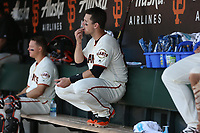 SAN FRANCISCO, CA - APRIL 27:  Buster Posey #28 of the San Francisco Giants sits in the dugout during the game against the Los Angeles Dodgers at AT&T Park on Thursday, April 27, 2017 in San Francisco, California. (Photo by Brad Mangin)