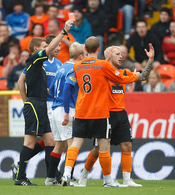 Johnny Russell is red carded by referee Callum Murray acfter a headbut on Kirk Broadfoot
