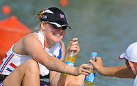 Brest, Belarus.  GBR BW4-, Polly SWANN, hands the water bottles to the boat holder at the start.  2010. FISA U23 Championships. Thursday,  22/07/2010.  [Mandatory Credit Peter Spurrier/ Intersport Images]