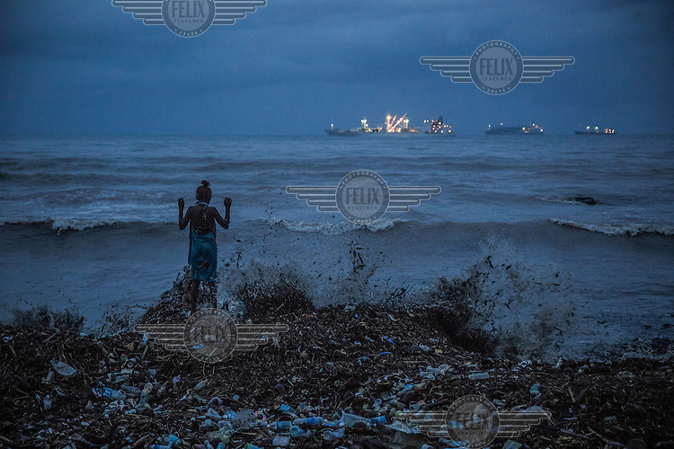 A girl standing on the shore, among made made and natural debris' during a high tide and flooding in Lord Howe Settlement. Lord Howe Settlement, a district of the capital Honaria, is populated by people from Ontong Java Atoll (AKA Lord Howe Atoll), a Polynesian outlier of the Solomon Islands. Its people have been moving to Lord Howe Settlement in search of a better life since the 1970s. Climate change leading to rising sea levels and consequent food insecurity now means the atoll is existentially threatened. The remaining Ontong Javanese people are considering the possibility of complete relocation to Santa Isabel Island and to Honiara. However, with Lord Howe Settlement itself suffering the consequences of extreme weather and overcrowding, community leaders believe it is not a viable long term home. Furthermore, they fear that the Ontong Javanese people's Polynesian identity will be lost as a new generation is brought up in a location with no connection to ancestral land. Their identity will be weakened as they become a minority amongst Melanesian communities that have vastly different traditions and speak different languages.