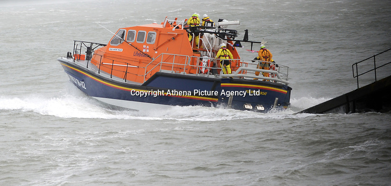 "Pictured: An RNLI lifeboat is launched during the high winds in Tenby, Wales, UK. Saturday 21 October 2017<br /> Re: Coastal parts of the UK is facing winds of up to 70mph as Storm Brian causes roads to close and public transport to be cancelled.<br /> Roads in Aberystwyth's seafront and at nearby Aberaeron, Wales are shut on Saturday morning as a yellow ""be aware"" Met Office warning is in place.<br /> Seven flood warnings have been issued for the west Wales coast."