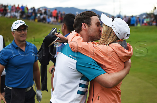 13.03.2016. Arrowtown, New Zealand.  Australia's Matthewe Griffin kisses his girlfriend Liz Johnston after winning the NZ Open at The Hills during 2016 BMW ISPS Handa New Zealand Open. Sunday 13 March 2016.