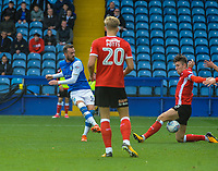 Barnsley's defender Angus MacDonald (5) blocks Sheffield Wednesday's forward Steven Fletcher (9) during the Sky Bet Championship match between Sheff Wednesday and Barnsley at Hillsborough, Sheffield, England on 28 October 2017. Photo by Stephen Buckley / PRiME Media Images.