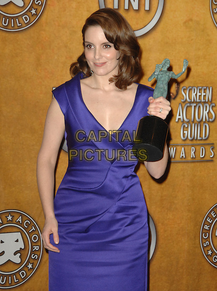 TINA FEY .16th Annual Screen Actors Guild Awards - Press Room held at The Shrine Auditorium, Los Angeles, California, USA, 23rd January 2010..SAG SAGs half length purple dress  award trophy winner trophy                .CAP/RKE/DVS .©DVS/RockinExposures/Capital Pictures