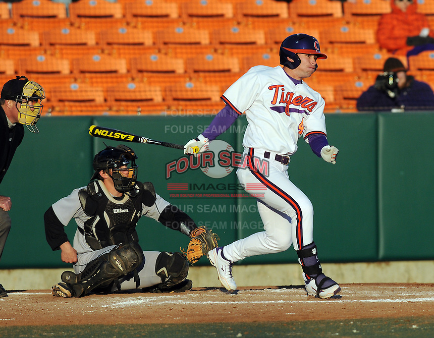Center fielder Thomas Brittle (4) of the Clemson Tigers in a game against the Wofford Terriers on Wednesday, March 6, 2013, at Doug Kingsmore Stadium in Clemson, South Carolina. Clemson won, 9-2. (Tom Priddy/Four Seam Images)