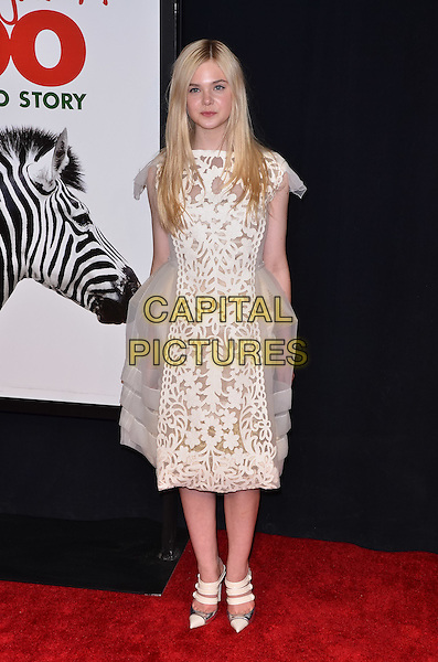 "Elle Fanning.""We Bought A Zoo"" New York Premiere, New York City, NY, USA..December 12th, 2011.full length dress tulle white lace sheer print .CAP/ADM/CS.©Christopher Smith/AdMedia/Capital Pictures."