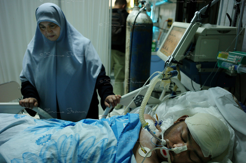 Tripoli, Libya, August 25, 2011.Fusia Abu Dayed, 50, watches over her son, Mohammed Hamad, 26, a doctor in the hospital who was shot in the head by a Khaddafi sniper as he was taking care of a victim in an ambulance at the hospital gate. Tripoli central hospital operates under very difficult circumstances, lacking personnel and supplies such as medecines, oxygen and dressings.