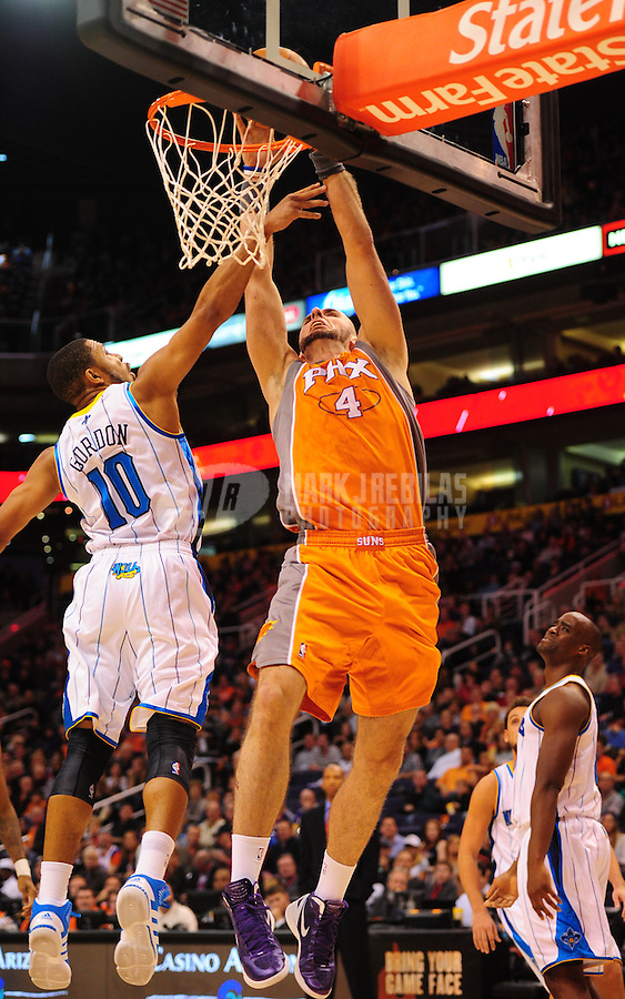 Dec. 26, 2011; Phoenix, AZ, USA; Phoenix Suns center Marcin Gortat (4) drives to the basket against New Orleans Hornets guard Eric Gordon (10) at the US Airways Center. The Hornets defeated the Suns 85-84. Mandatory Credit: Mark J. Rebilas-USA TODAY Sports