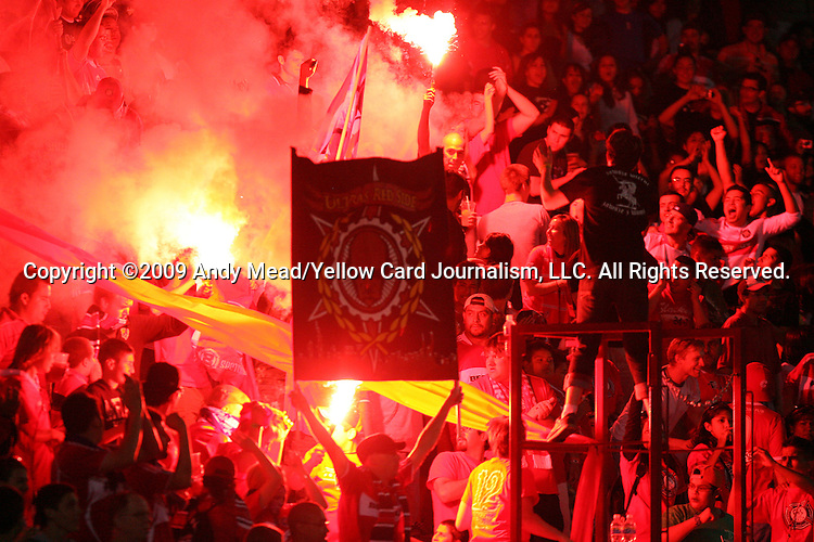 05 June 2009: Chicago fans in Section 8 burn flares while cheering for the team in the second half. The Houston Dynamo defeated the Chicago Fire 1-0 at Toyota Park in Bridgeview, Illinois in a regular season Major League Soccer game..