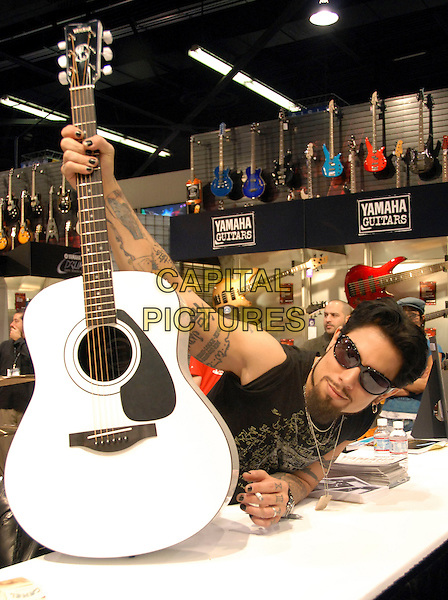 DAVE NAVARRO - THE PANIC CHANNEL.Makes a special appearance at Yamaha Guitars' Booth at The NAMM 2006 Convention at The Anaheim Convention Center in Anaheim, California   .January 21st, 2006..Ref: DVS.half length tattoos guitar sunglasses shades.www.capitalpictures.com.sales@capitalpictures.com.Supplied By Capital PIctures