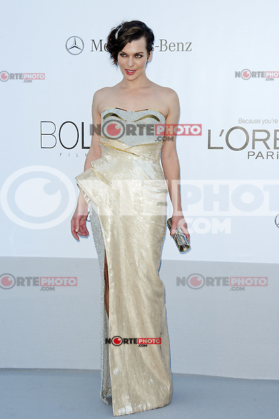 """Milla Jovovich attending the """"On the Road"""" Premiere during the 65th annual International Cannes Film Festival in Cannes, France, 23rd May 2012. Milla Jovovich wore a Versace dress...Credit: Timm/face to face, / Mediapunchinc"""