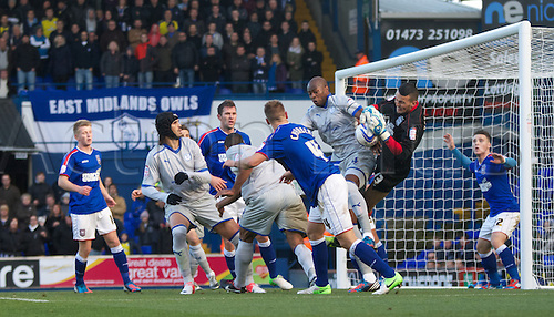 27.10.12 Ipswich, England. Ipswich goalkeeper Stephen Henderson  collects the cross under heavy pressure during the Championship game between Ipswich Town and Sheffield Wednesday at Portman Road