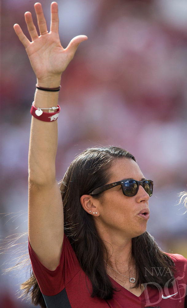 Hawgs Illustrated/Ben Goff<br /> Courtney Deifel, Arkansas softball head coach, and the team take recognition during a timeout in the game vs Eastern Illinois Saturday, Sept. 1, 2018, at Razorback Stadium in Fayetteville.