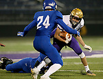 SIOUX FALLS, SD - OCTOBER 25: Sam Kruger #14 from Winner tries to elude a pair of defenders including Collin Reitsma #24 from Sioux Falls Christian in the first half of their 11B playoff game Thursday nigh at Bob Young Field in Sioux Falls.(Photo by Dave Eggen/Inertia)