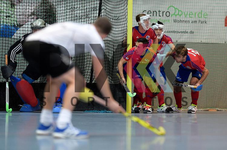 GER - Mannheim, Germany, November 28: During the 1. Bundesliga Sued Herren indoor hockey match between Mannheimer HC (red) and TG Frankenthal (white) on November 28, 2015 at Irma-Roechling-Halle in Mannheim, Germany. Final score 7-7 (HT 3-3). <br /> <br /> Foto &copy; PIX-Sportfotos *** Foto ist honorarpflichtig! *** Auf Anfrage in hoeherer Qualitaet/Aufloesung. Belegexemplar erbeten. Veroeffentlichung ausschliesslich fuer journalistisch-publizistische Zwecke. For editorial use only.