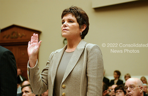 "Washington, D.C. - September 28, 2006 -- Patricia Dunn, former Chairman of the Board, Hewlett-Packard Company, is sworn-in to testify before the United States House Subcommittee on Oversight and Investigations hearing on "" Hewlett-Packard's Pretexting Scandal"" in Washington, D.C. on September 28, 2006..Credit: Ron Sachs / CNP.[No New York Metro or other Newspapers within a 75 mile radius of New York City]"