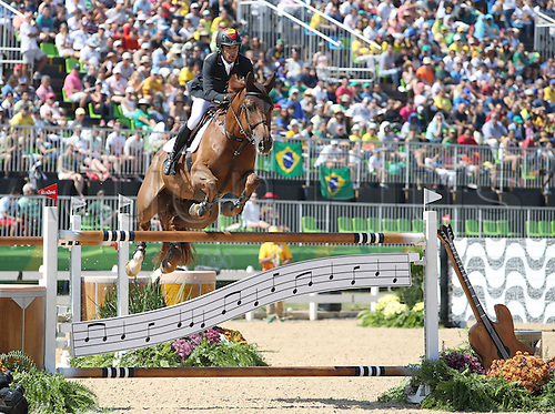 14.08.2016. Rio de Janeiro, Brazil. Manuel Fernandez Saro of Spain on horse U Watch clears an obstacle during the Jumping Team 1st Qualifier of the Equestrian competition at the Olympic Equestrian Centre during the Rio 2016 Olympic Games in Rio de Janeiro, Brazil, 14 August 2016.