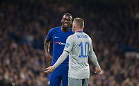 Goalscorer Antonio Rudiger of Chelsea laughs in a frustrated Wayne Rooney of Everton face during the Carabao Cup round of 16 match between Chelsea and Everton at Stamford Bridge, London, England on 25 October 2017. Photo by Andy Rowland.