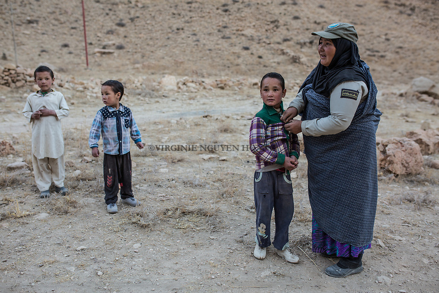 Hamina is welcomed by one of her son and her grandsons near her house. At home, she has to take care of  11 children, 6 are hers, 5 are from the daughter of her husband's first wife who lives in Iran. Afghanistan, 9th november 2017.<br /> <br /> Hamina est acceuillie par un de ses fils et petits fils pr&egrave;s de sa maison. Chez elle, elle doit s'occuper de 11 enfants, 6 d'entre eux sont d'elle, les 5 autres sont les enfants de la fille de la premi&egrave;re femme de son marie, Afghanistan, 9 novembre 2017.
