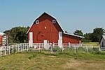 Red barn, white pole fence, rural Nebraska.