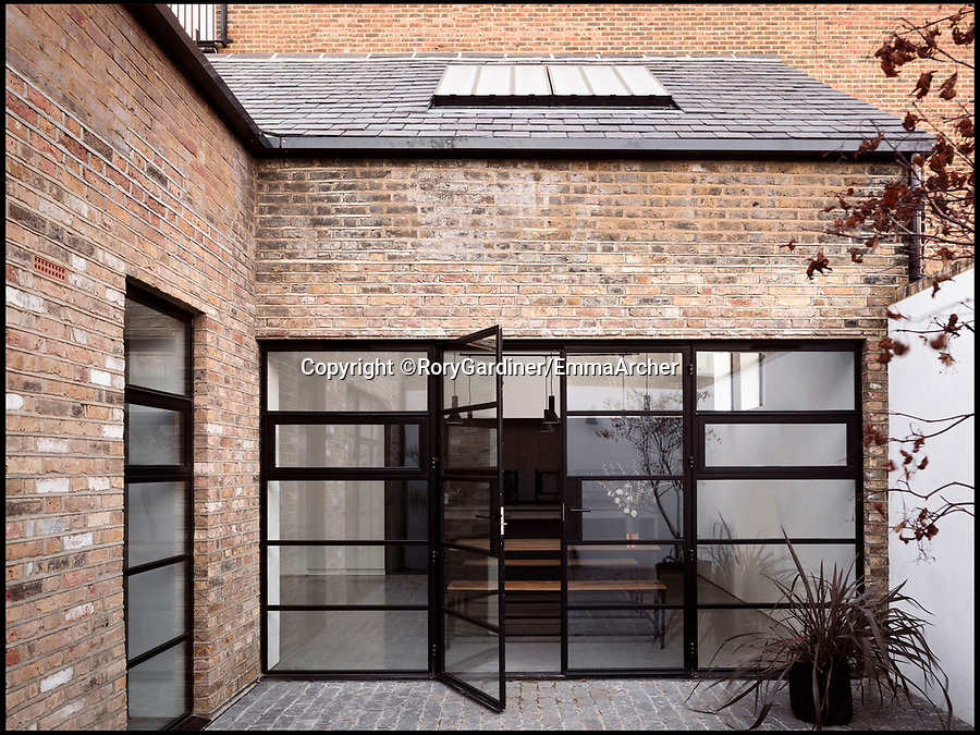 BNPS.co.uk (01202 558833)Pic: RoryGardiner/EmmaArcher/BNPS<br /> <br /> Private courtyard garden...<br /> <br /> Council Depot transformed into a million pound minimalist masterpiece.<br /> <br /> An architect has transformed a former council depot in Hackney into a stunning £1.35million property.<br /> <br /> James Davies, 34, has spent two years transforming the historic, dilapidated former school building in Stoke Newington, north east London, into a modern, stylish two-storey, two-bedroom house, living on site during the conversion. <br /> <br /> The renovation of the site at Defoe Road, which is yards from the high street, cost a hefty £350,000.<br /> <br /> But the investment has paid off handsomely as the property, which has its own inner courtyard, has already been snapped up for £1.35m.