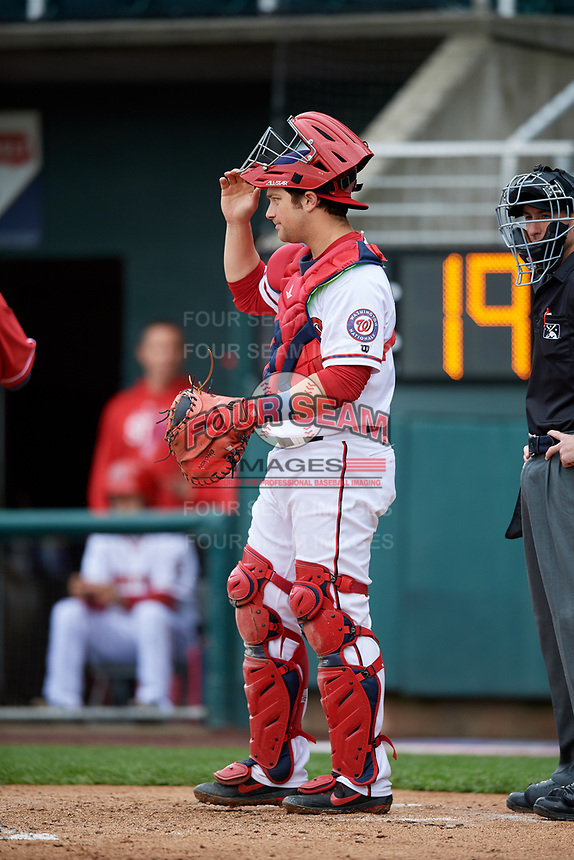 Harrisburg Senators catcher Taylor Gushue (36) in front of home plate umpire Sean Shafer-Markle during the first game of a doubleheader against the New Hampshire Fisher Cats on May 13, 2018 at FNB Field in Harrisburg, Pennsylvania.  New Hampshire defeated Harrisburg 6-1.  (Mike Janes/Four Seam Images)