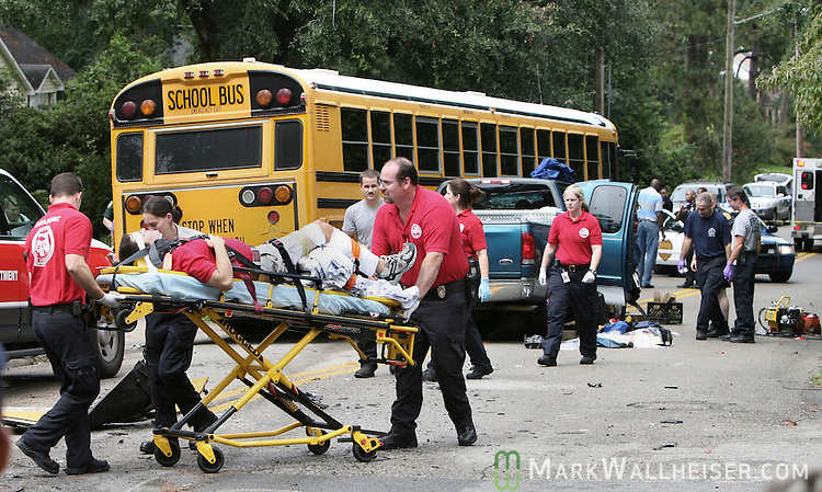 Leon County paramedics transport the driver of the pick up that collided with a Leon County School bus with 42 children from Cobb Middle School at the intersection of 7th Ave and Mitchell St. in Tallahassee, Florida September 14, 2007.  (Mark Wallheiser/TallahasseeStock.com)