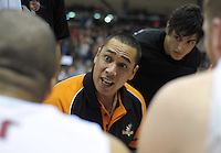 Sharks coach Paul Henare talks to his team during a timeout in the national basketball league match between Wellington Saints and Southland Sharks at the TSB Bank Arena, Wellington, New Zealand on Friday, 5 July 2013. Photo: Dave Lintott / lintottphoto.co.nz