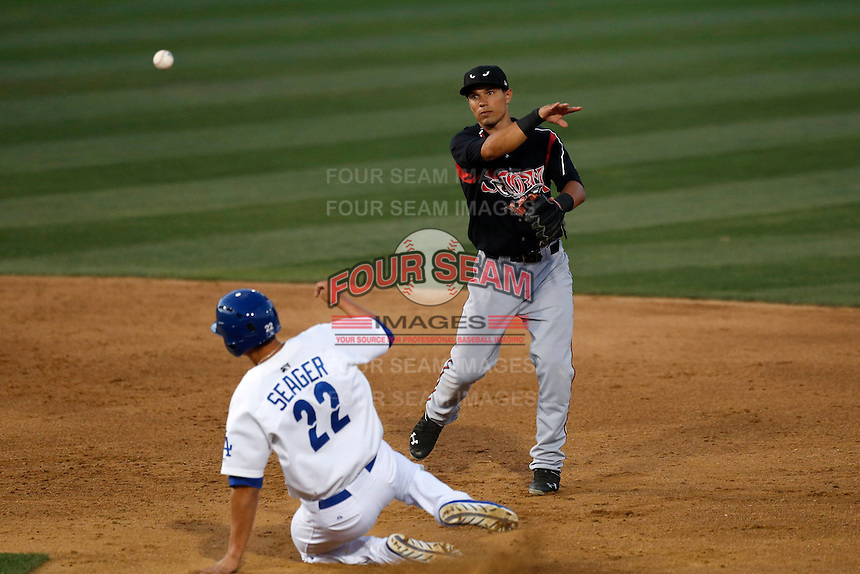 Jace Peterson #6 of the Lake Elsinore Storm throws to first base after forcing out Corey Seager #22 of the Rancho Cucamonga Quakes at second base during a game at LoanMart Field on August 6, 2013 in Rancho Cucamonga, California. Lake Elsinore defeated Rancho Cucamonga, 13-5. (Larry Goren/Four Seam Images)