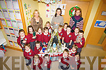 ...CRAFT: Catherine Spangler getting an helping hand from Junior Infants on Tuesday at St Brendan's National School Fenit in knitting the 20011 school Christmas crib with their Teacher Eimear De Brún  and Ailing O'Sullivan (Principal). Junior infants Ciara Collins, Alicia Cronin, Billy Doyle, Lana Gaudino, Ryan Hickey, Hugh Lenihan, Maurice Lenihan, Alison Moriarty, Aoife O'Brien, Conor O'Sullivan, Eileen O'Sullivan, Lily Amy Parker, Nell Ryan Moriarty, Ksawier Skwira,Bobby Sugrue and Shane Williams...............