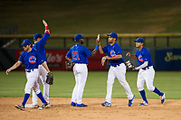 AZL Cubs Tolly Filotei (24), Cam Balego (82), Delvin Zinn (21), Yovanny Cuevas (61), and Jose Gutierrez (91) congratulate one another after a victory against the AZL Padres 2 on August 28, 2017 at Sloan Park in Mesa, Arizona. AZL Cubs defeated the AZL Padres 2 9-4. (Zachary Lucy/Four Seam Images)