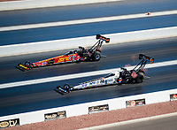 Nov 3, 2019; Las Vegas, NV, USA; NHRA top fuel driver Brittany Force (top) races alongside teammate Austin Prock during the Dodge Nationals at The Strip at Las Vegas Motor Speedway. Mandatory Credit: Mark J. Rebilas-USA TODAY Sports