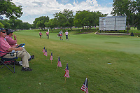 American flags surround volunteer scorers on this Memorial Day weekend as Jon Rahm (ESP) approaches the green on 18 during round 3 of the Fort Worth Invitational, The Colonial, at Fort Worth, Texas, USA. 5/26/2018.<br /> Picture: Golffile | Ken Murray<br /> <br /> All photo usage must carry mandatory copyright credit (&copy; Golffile | Ken Murray)