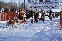 Saturday, February 24th, Knik, Alaska.  Jr. Iditarod musher David May leaves start line on Knik Lake