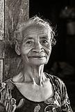 INDONESIA, Flores, Ngada District, portrait of a local woman basket weaver at  Belaraghi Village
