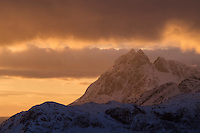 Winter sunrise over Solbjørn mountain peak, Moskenesøy, Lofoten Islands, Norway