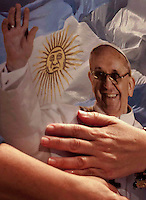 A woman holds a poster of Pope Francis at the Metropolitan Cathedral in Buenos Aires March 17, 2013. Photo by Juan Gabriel Lopera / VIEWpress.