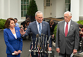 United States Senate Minority Leader Chuck Schumer (Democrat of New York), center, speaks to reporters at the White House in Washington, DC after a meeting with US President Donald J. President Donald J. Trump  on Wednesday, October 16, 2019.  At left is Speaker of the US House of Representatives Nancy Pelosi (Democrat of California) and at right is US House Majority Leader Steny Hoyer (Democrat of Maryland).<br />