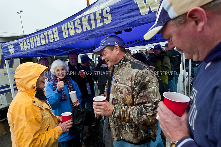 10/30-2010--Seattle, WA, USA..Jake (Jacob) Locker, 22, is the quarterback for the University of Washington Huskies football team. He is the starting quarterback at the on the teak and a top NFL draft prospect when he graduates in 2011. Originally from Ferndale, WASH., Scott Locker, Jake's father and friends and family from Ferndale have been regular tailgaters at all his games in a group called the 'Ferndawgs'...Here Jake's father, Scott Locker, 45, (2nd from right)relaxes with fellow Ferndawg tailgaters before the game against Stanford, which the Huskies would lose 41-0 at home...©2010 Stuart Isett. All rights reserved.