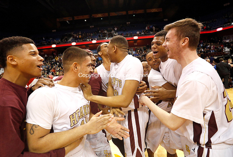 Uncasville, CT- 22 March 2015-032215CM32- Sacred Heart boys basketball team celebrates after the Hearts defeated Valley Regional in Class S state championship game at Mohegan Sun Arena in Uncasville on Sunday. The Hearts won, 71-46.    Christopher Massa Republican-American