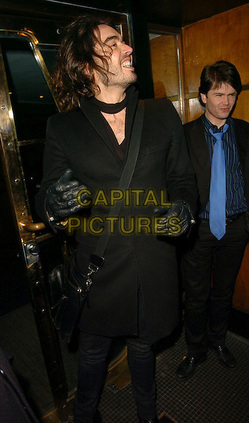 RUSSELL BRAND.Celebrity Big Brother Wrap Party at Astor Bar & Grill, London, UK..January 30th, 2006.Ref: CAN.half length black coat gloves.www.capitalpictures.com.sales@capitalpictures.com.©Capital Pictures