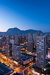 Night view of Benidorm and Puig Campana mountain, Alicante, Comunidad Valenciana, Spain.