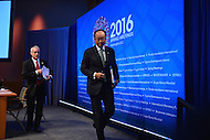 Washington, DC - April 14, 2016: Jim Yong Kim (c), President of the World Bank Group, exits the press briefing room at the IMF headquarters in the District of Columbia after briefing members of the media, April 14, 2016, escorted by communications advisor John Donnelly.  (Photo by Don Baxter/Media Images International)