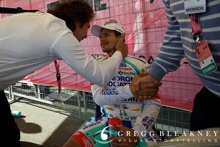 Rujano shares a moment with team Androni coach Marco Bellini after his second place finish--he was the only true challenger to Contador during the Giro's first mountain stage.