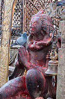 Nepal, Changu Narayan.  Garuda Statue, Sprinkled with Red Kumkuma Powder.