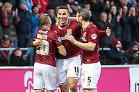 Rod McDonald of Northampton Town (centre) celebrates scoring his team's third goal against Morecambe to make it 3-0 with Tony Thompson (left) and Zander Diamond (right) during the Sky Bet League 2 match between Northampton Town and Morecambe at Sixfields Stadium, Northampton, England on 23 January 2016. Photo by David Horn / PRiME Media Images.